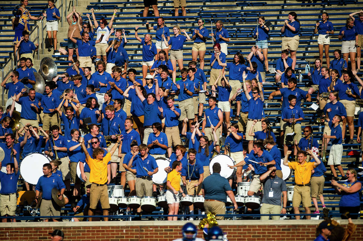 The Midland High marching band celebrate a touchdown during the Chemics' game against Traverse City West Thursday, Aug. 26, 2021 at Michigan Stadium in Ann Arbor. (Katy Kildee/kkildee@mdn.net)