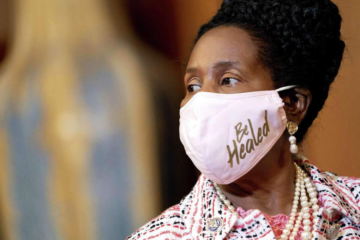 Representative Sheila Jackson-Lee, a Democrat from Texas, listens during a news conference at the U.S. Capitol in Washington, D.C., U.S., on Tuesday, Aug. 24, 2021. The House adopted a $3.5 trillion budget resolution after a White House pressure campaign and assurances from Speaker Pelosi helped unite fractious Democrats to move ahead on the core of President Biden's economic agenda. Photographer: Stefani Reynolds/Bloomberg
