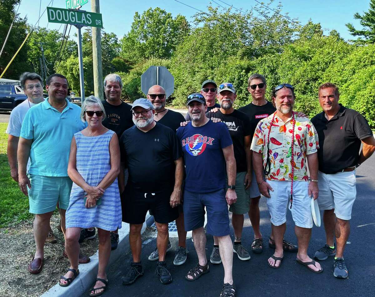A group who grew up in Flower Estates neighborhood in West Norwalk in the 1960s recently reunited in the neighborhood. Back row, from left, Mike Concordia, Nate Shipp, Walter Roman, Bob Kline, Don Hunnyman, David Young, Michael Young, Greg Young and Don Cafaro. Front row, from left, Sarah Relyea Kline, Jonathan Trost and Jonathan Zarkower.