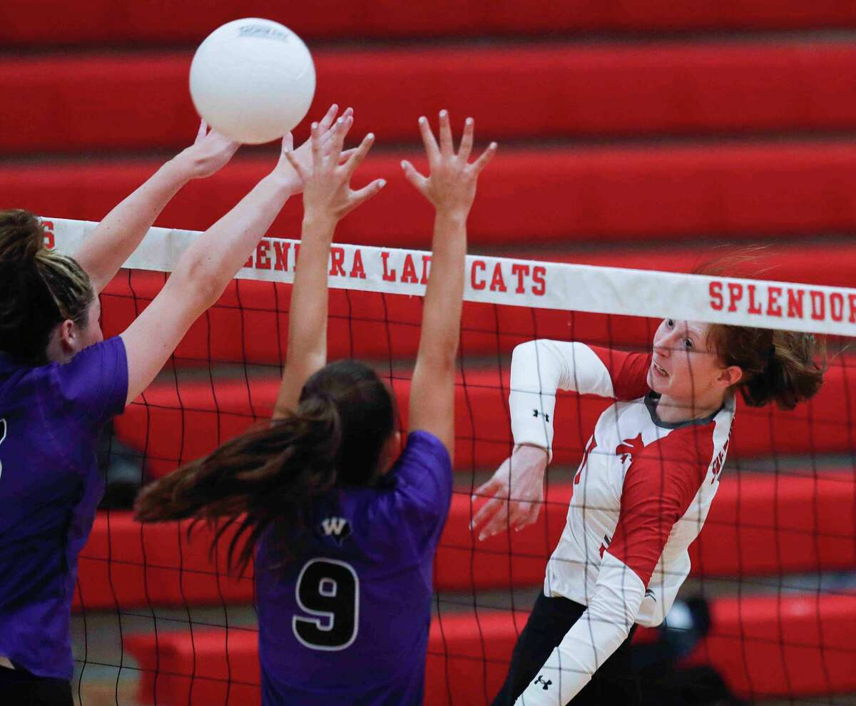 Splendora's Jalynn Knight (5) gets a shot past Willis' Taylor Hayes (9) and Secret Carroll (12) in the second set during a non-district high school volleyball match at Splendora High School, Friday, Aug. 20, 2021, in Splendora.