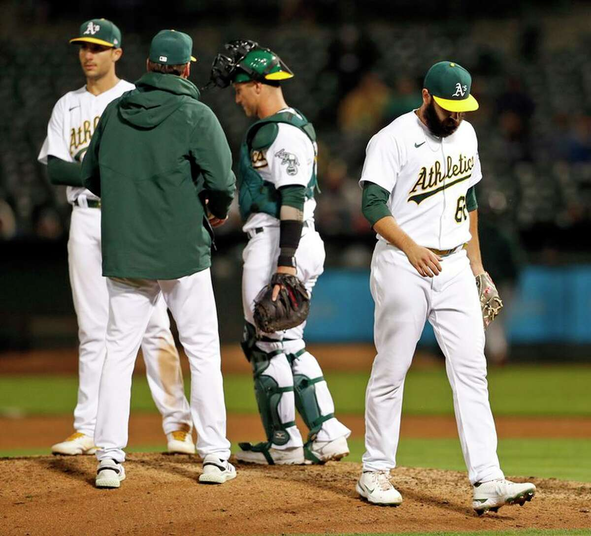 A's reliever Lou Trivino exits the game after the Mariners scored three runs against him in the ninth inning Monday.