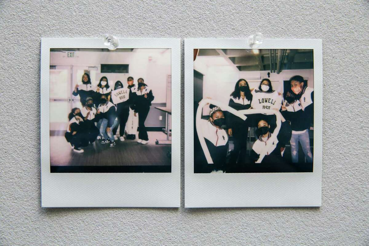 Polaroid photos show Lowell High School Black Student Union leaders Arianna Grice, Aubrey Chikere, Gabrielle Grice, Aliyah Hunter, Anais Gauthier and Hannah Chikere pose with other students on campus.
