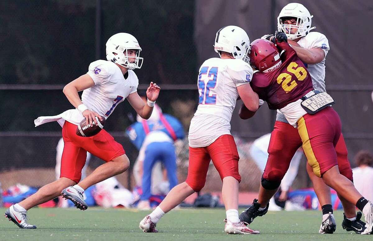 Quarterback Aidan Smith (left) will lead St. Ignatius into its season opener at Palo Alto.
