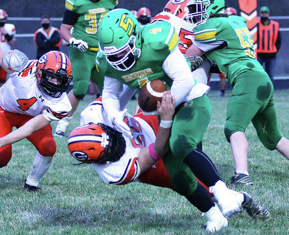 Southwestern's Blake Funk (4) takes on a Gillespie defender during a SCC game last spring in Piasa. Funk joins Gavin Day to give the Piasa Birds the top returning rushing combination in the league in 2021.