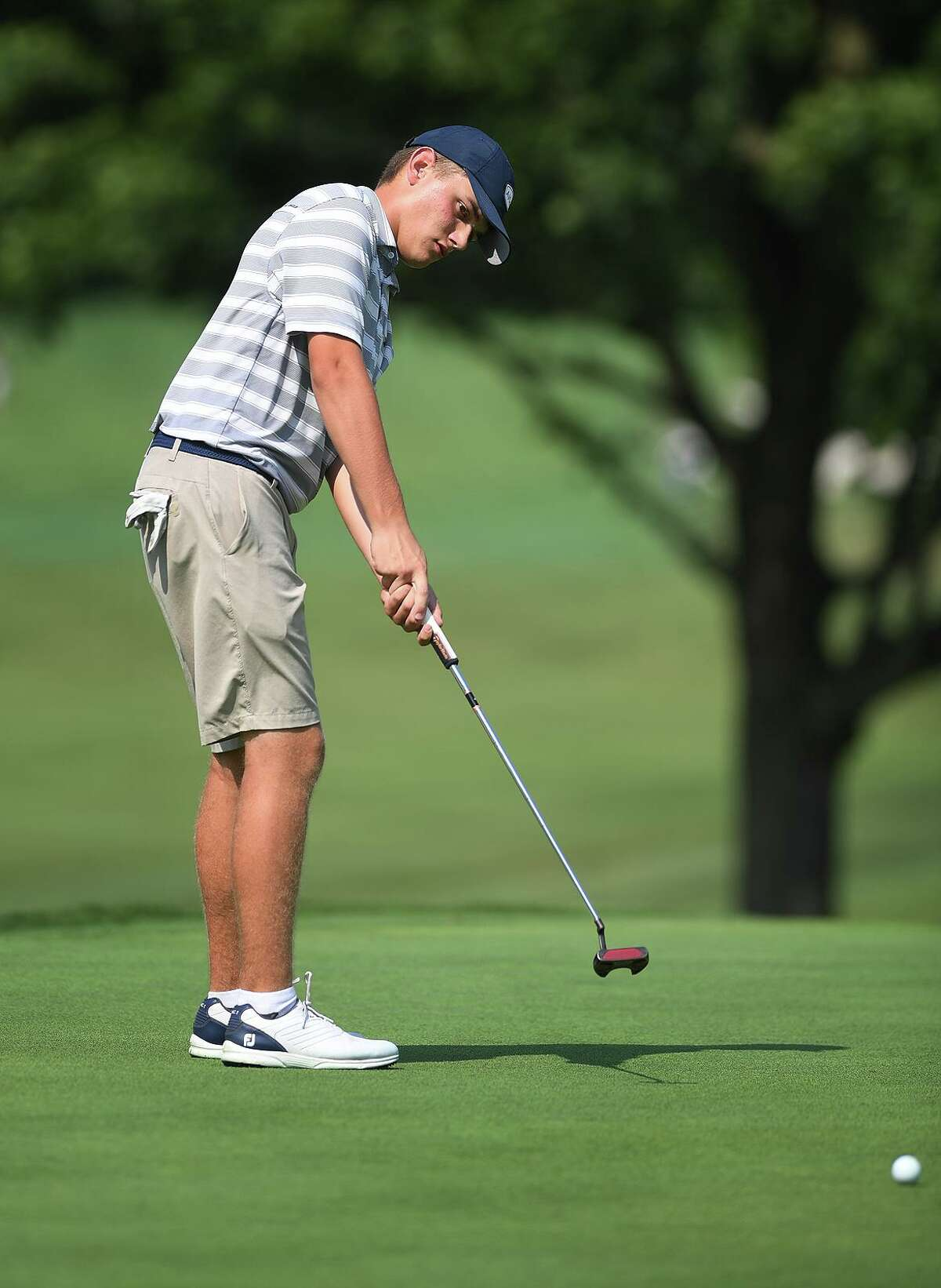 Alex Elia of Silver Spring Country Club putts on the 13th green during quarterfinal match play at the 50th Jay Borck Jr. Golf Tournament at Brooklawn Country Club in Fairfield, Conn. on Tuesday, July 30, 2019.