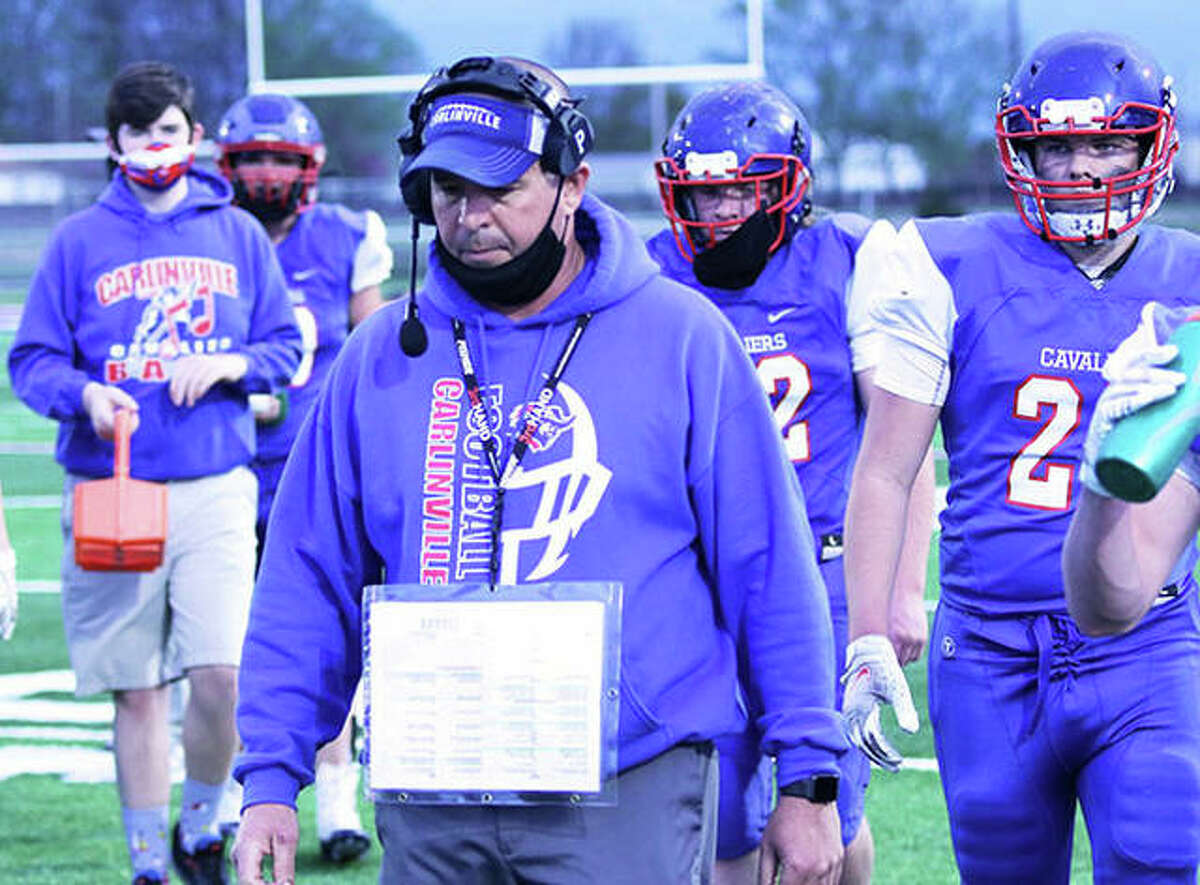 Carlinville coach Chad Easterday walks to the sideline before a game last season in Carlinville. The Cavs finished 5-1 in the spring season and Easterday begins his 14th season as coach with a 104-36 record.
