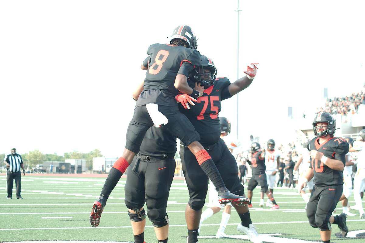 Clear Brook?•s Jason Lopez (78), Clear Brook?•s Donovan Jacob (75) and Clear Brook?•s Cameron McCalister (8) celebrate a touchdown against Texas City Thursday, Aug. 26, 2021 at CCISD Challenger Columbia Stadium.