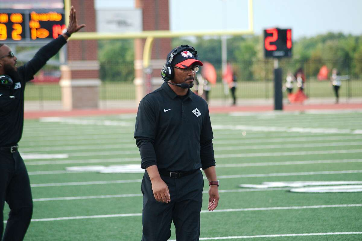 Clear Brook football coach John Towels walks the sideline as the Wolverines play Texas City Thursday, Aug. 26, 2021 at CCISD Challenger Columbia Stadium.