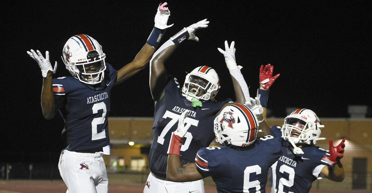 Atascocita wide receiver Keilon Jiones (6) celebrates his touchdown with Ty Berry (2), Roger Solache (75), and Eli Watt (12) during the second half of a high school football game against Klein Collins, Thursday, Aug. 26, 2021, in Humble.