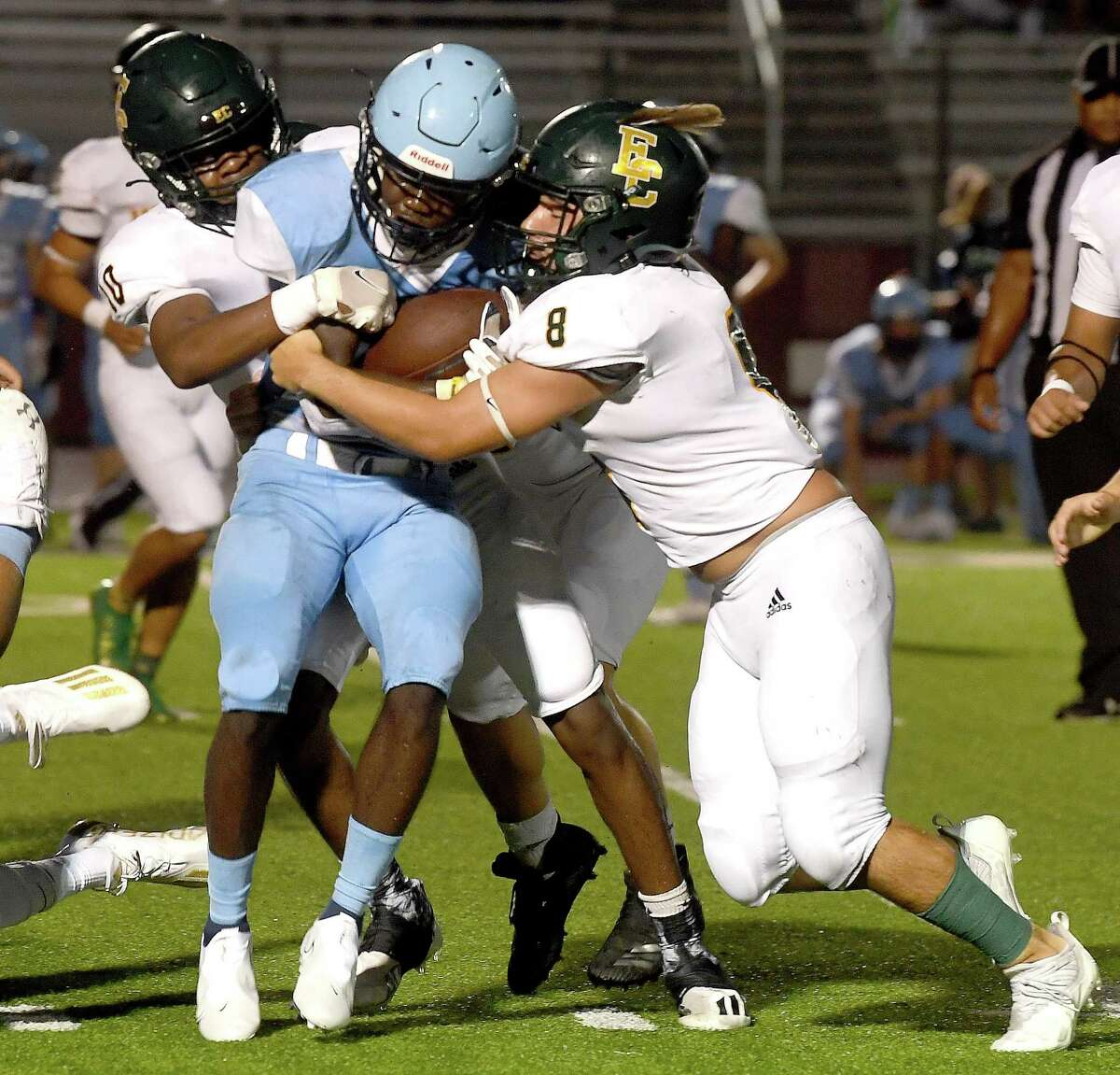 East Chambers' Cooper McKay pushes back aigainst West Rusk's advance during their game Thursday in Jasper. Photo made Thursday, August 26, 2021 Kim Brent/The Enterprise