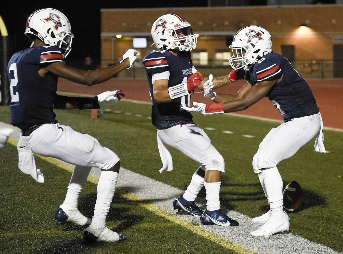 Atascocita wide receiver Keilon Jiones, right, celebrates his touchdown with Ty Berry, left, and Eli Wyatt during the second half of a high school football game against Klein Collins, Thursday, Aug. 26, 2021, in Humble.