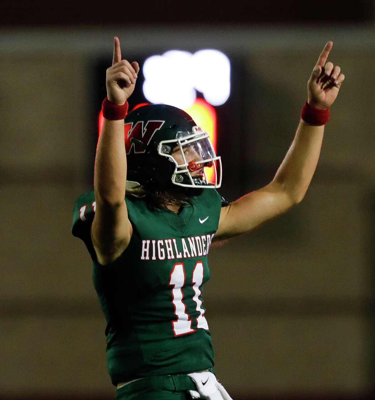 The Woodlands quarterback Mabrey Mettauer (11) reacts after throwing a 21-yard touchdown pass to wide receiver Ben Ferguson during the second quarter of a non-district high school football game at Woodforest Bank Stadium, Thursday, Aug. 26, 2021, in Shenandoah.
