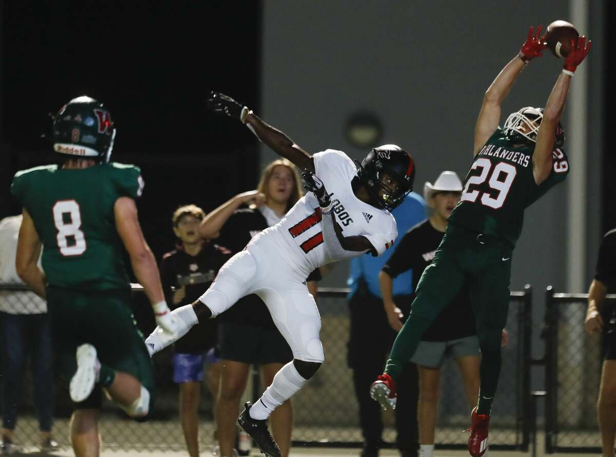 The Woodlands defensive back Caden Miller (29) intercepts a pass intended for Langham Creek wide receiever Jaquaize Pettaway (11) on fourth down during the second quarter of a non-district high school football game at Woodforest Bank Stadium, Thursday, Aug. 26, 2021, in Shenandoah.