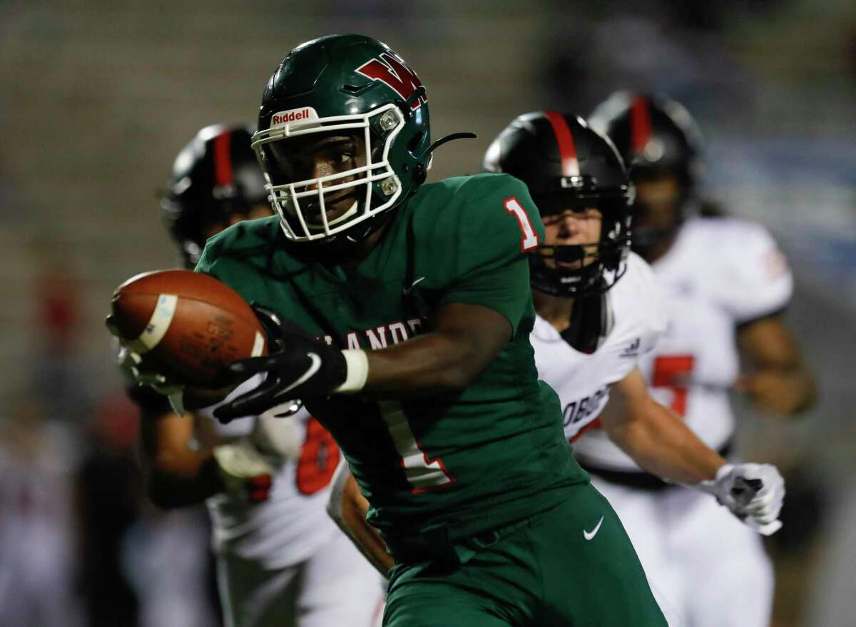 The Woodlands running back JoBarre Reed (1) stretches for a touchdown during the third quarter of a non-district high school football game at Woodforest Bank Stadium, Thursday, Aug. 26, 2021, in Shenandoah.