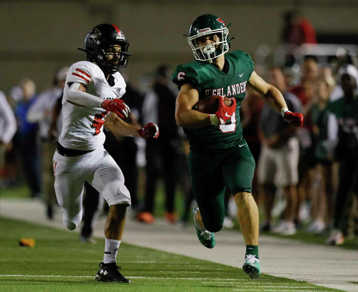 The Woodlands wide receiver Ben Ferguson (6) runs the ball during the third quarter of a non-district high school football game at Woodforest Bank Stadium, Thursday, Aug. 26, 2021, in Shenandoah.