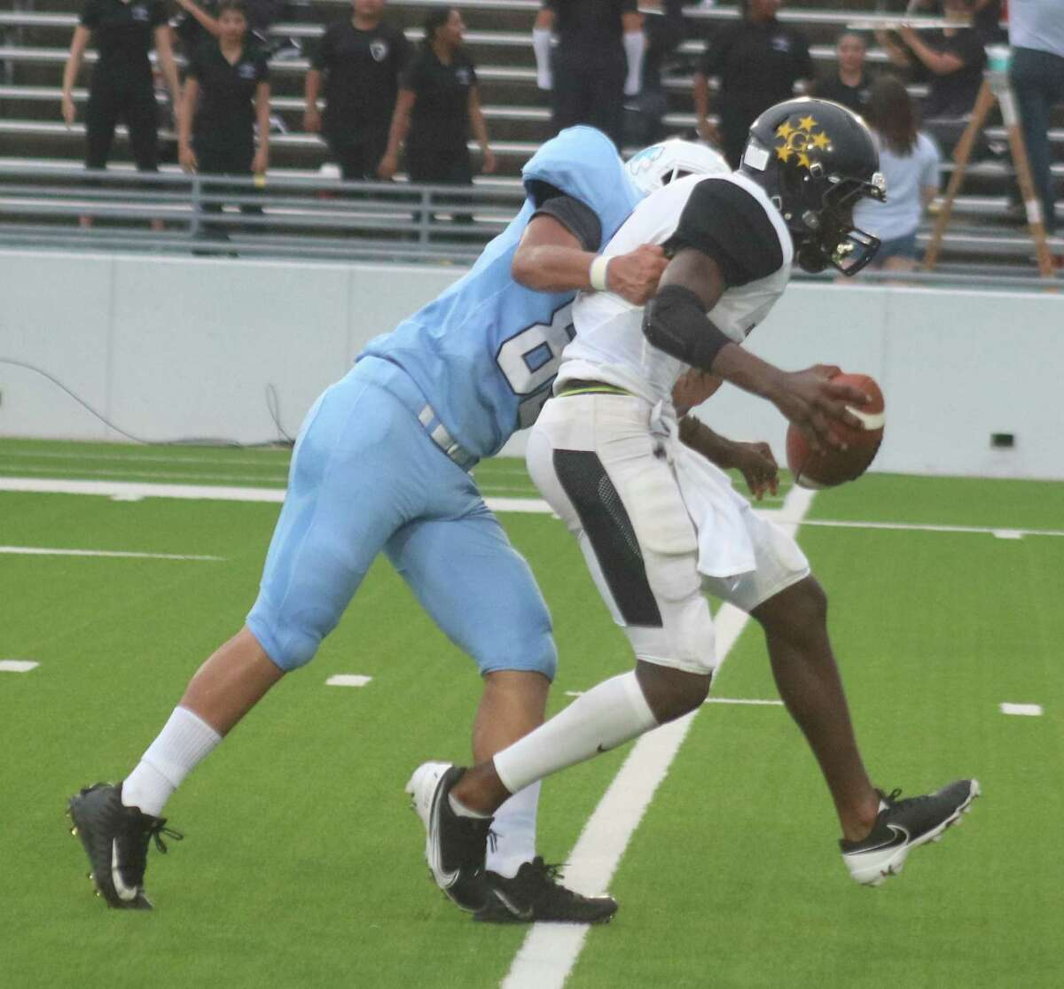 A Sam Rayburn defender sacks Houston Wisdom quarterback John Nsenguwera. The defense finished with a two-quarter shutout, just Rayburn's fifth shutout on opening night in 58 years.