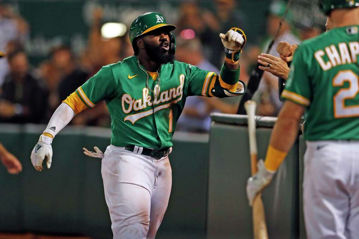 After trailing 6-0, Oakland Athletics' Josh Harrison ties the game in 5th inning with solo home run against New York Yankees during MLB game at Oakland Coliseum in Oakland, Calif., on Thursday, August 26, 2021.
