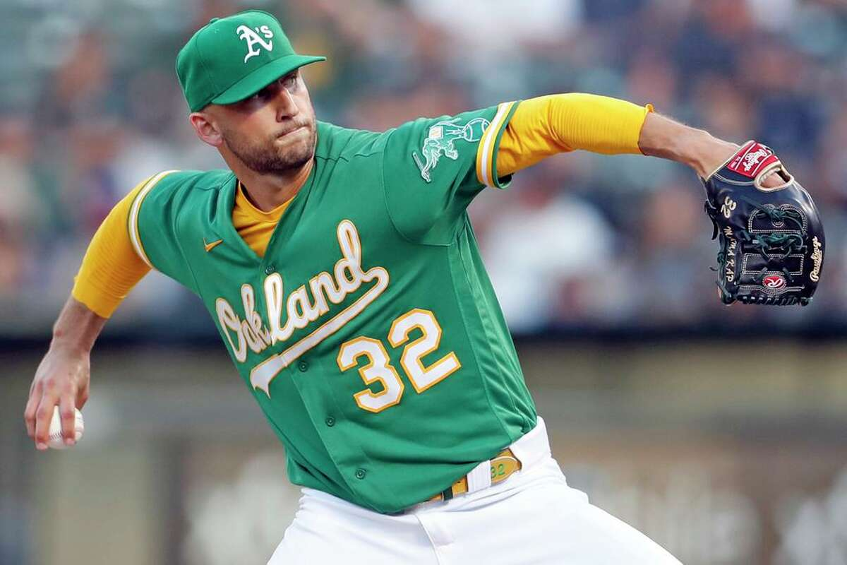 Oakland Athletics' starting pitcher James Kaprielian pitches in 1st inning against New York Yankees during MLB game at Oakland Coliseum in Oakland, Calif., on Thursday, August 26, 2021.