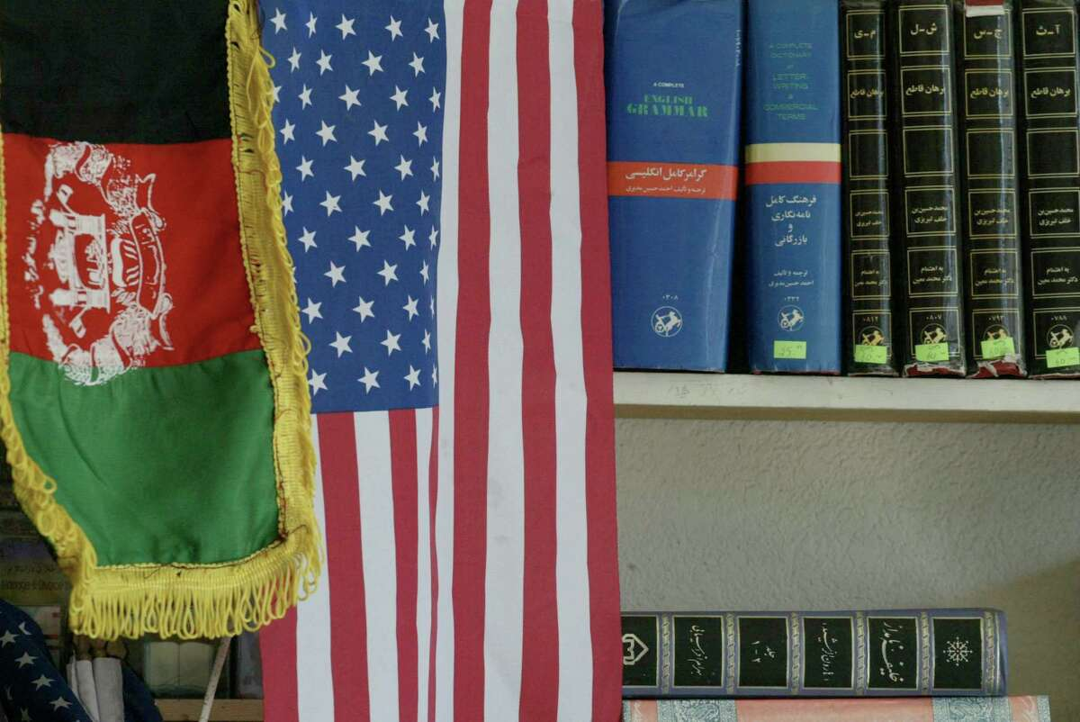 Little Kabul in Fremont, where Afghan and American flags decorate a market, is one of the largest Afghan communities in the U.S.