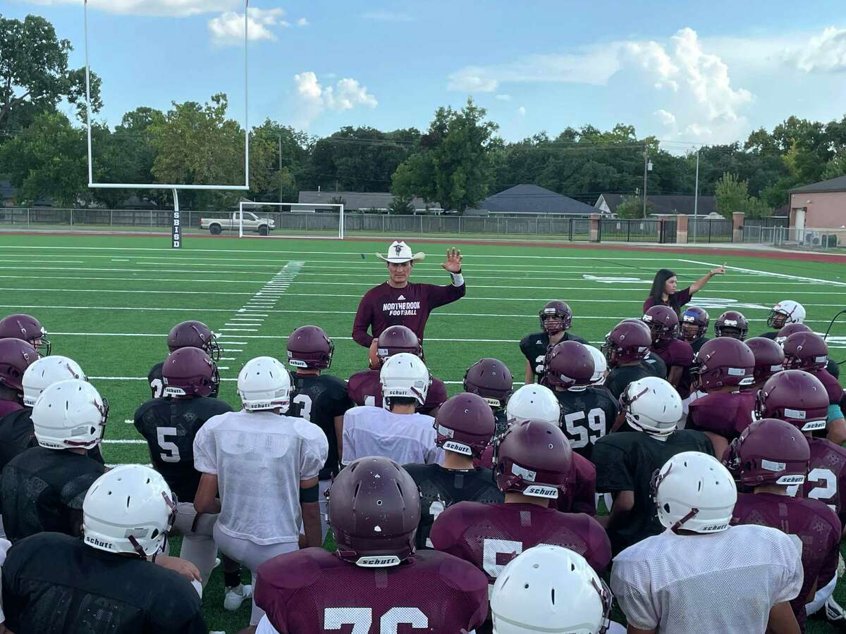 Coach Andres Gomez talks to the Northbrook football players at the end of practice on Aug. 24.