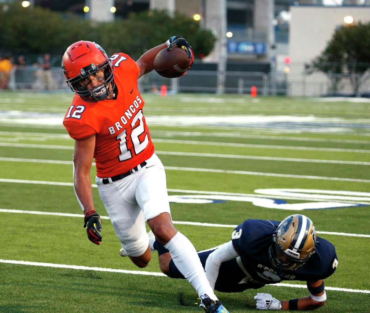 Brandeis Julian Yzaguirre(12) escapes a last tackler for their first touchdown. Brandeis defeated O'Connor 33-7 in boys football game on Thursday, Oct. 26, 2021 at Farris Stadium.