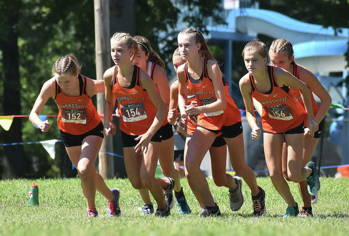 Members of the Edwardsville Tigers take off at the start of the Granite City Invitational last year inside Wilson Park in Granite City.