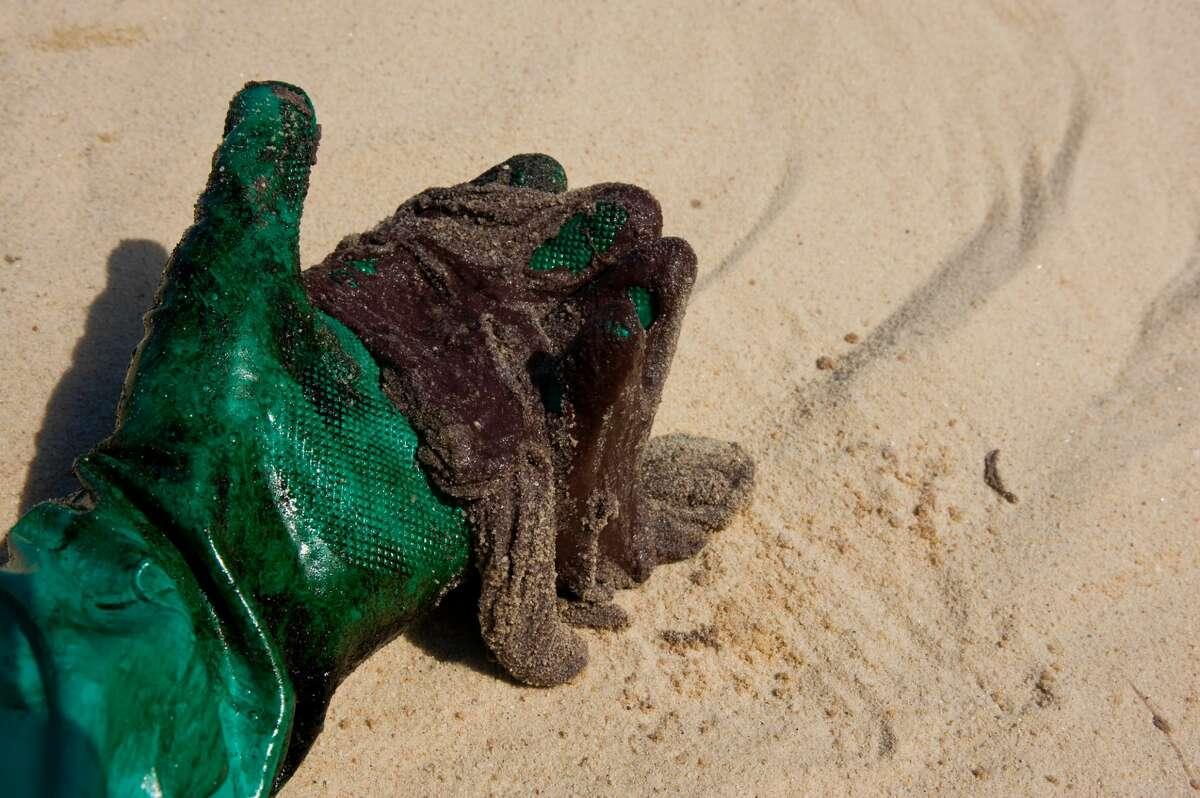 A file photo of a tar ball found on a beach.