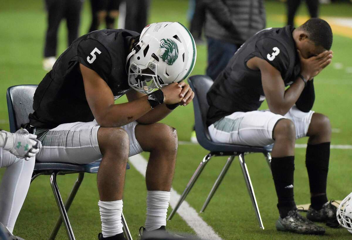 Spring quarterback Bishop Davenport (5) collect his thoughts during the final moments of the team's loss to DeSoto in a 6A Division I Region II regional semi-final high school football playoff game, Saturday, Dec. 26, 2020, in Waco, TX.