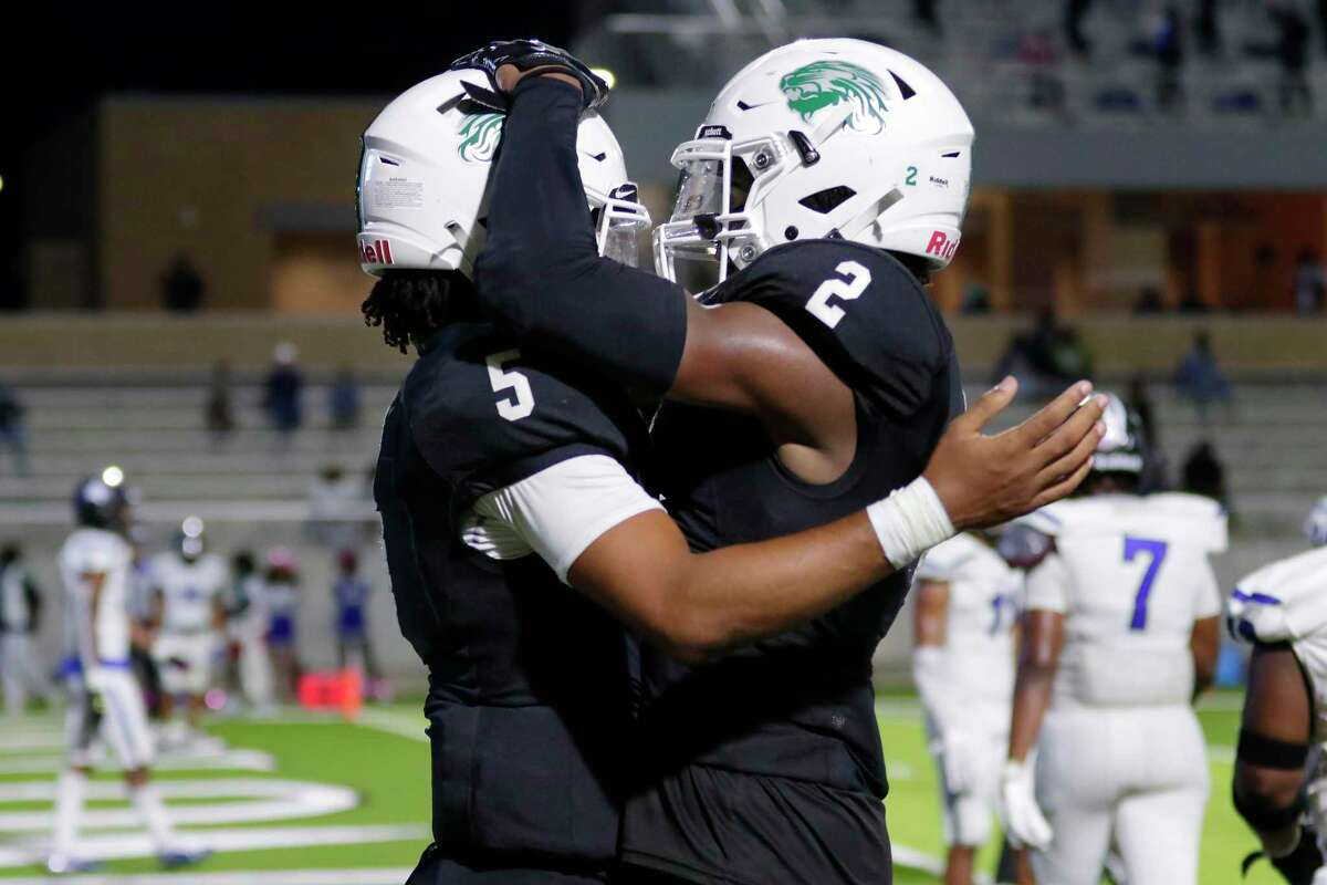 Spring quarterback Bishop Davenport (5) and wide receiver Aldyn Bradley (2) celebrate Davenports touchdown during the second half of a high school football game against the Dekaney Wildcats Friday, Oct. 9, 2020 at Planet Ford Stadium in Spring, TX.