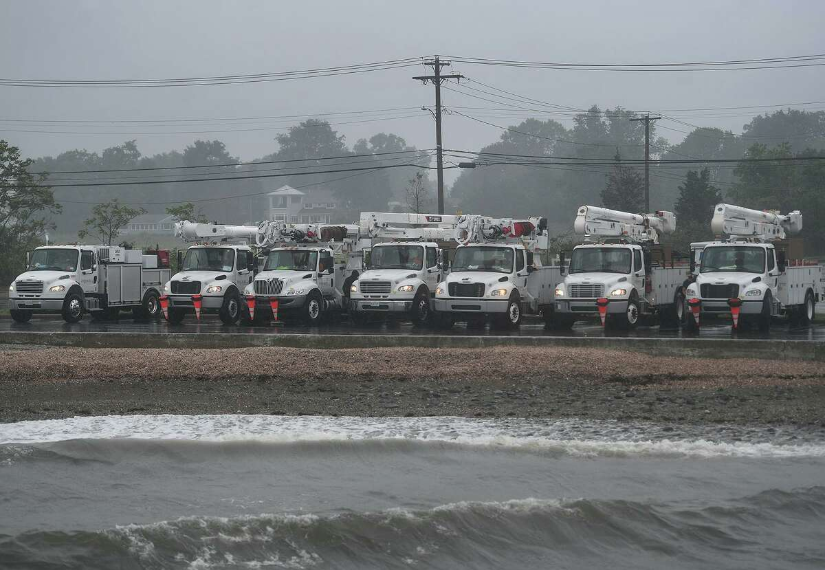 Utility trucks are staged to deal with any damage from Tropical Storm Henri at Gulf Beach in Milford, Conn. on Monday, August 23, 2021.