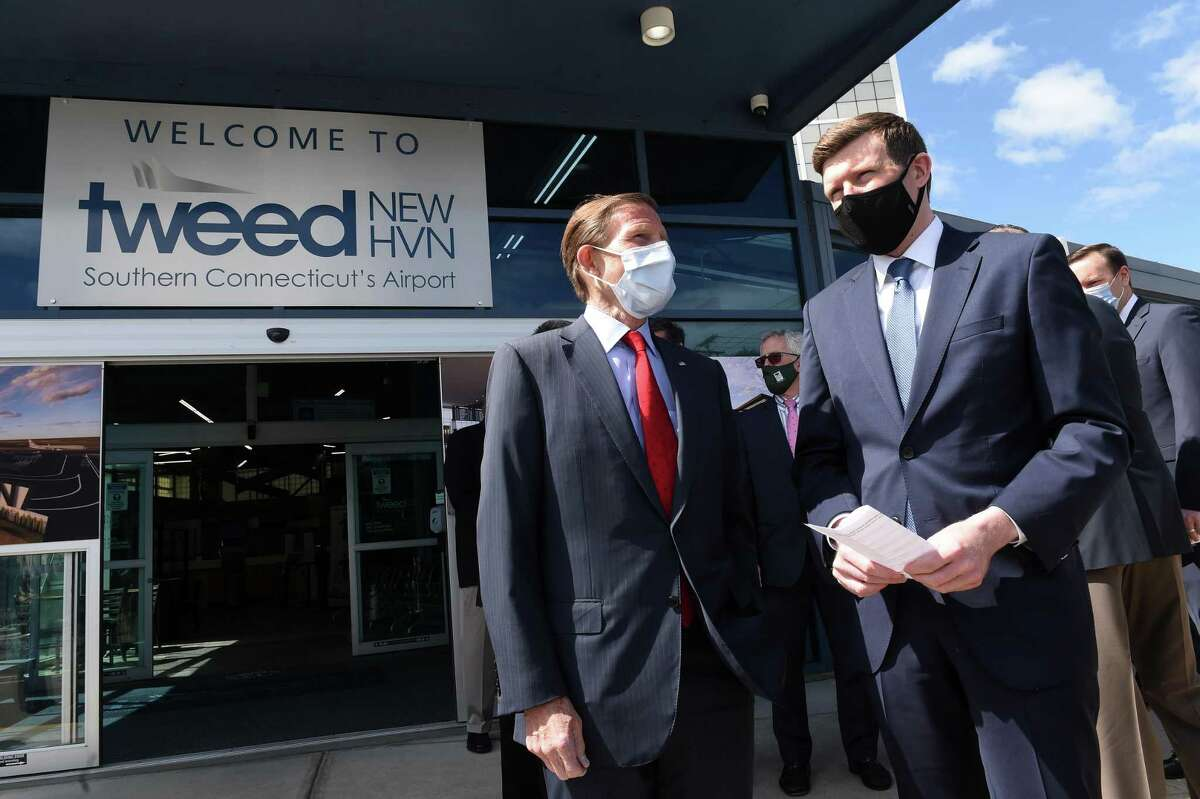 Sen. Richard Blumenthal, center, speaks with Sean Scanlon, executive director of the Tweed New Haven Airport Authority, at a press conference announcing expansion plans at Tweed New Haven Airport on May 6, 2021.