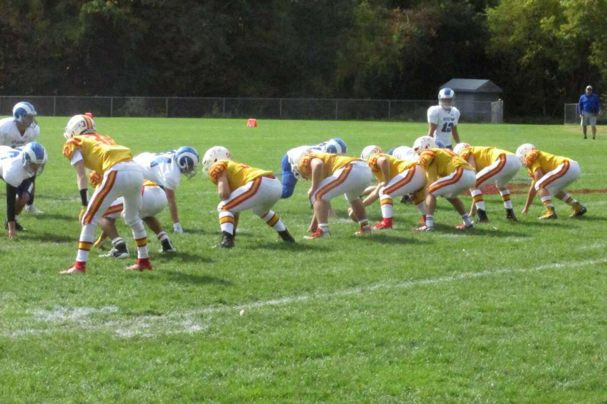 The Gilbert/Northwestern football team lines up against the Coventry co-op during the 2019 season.