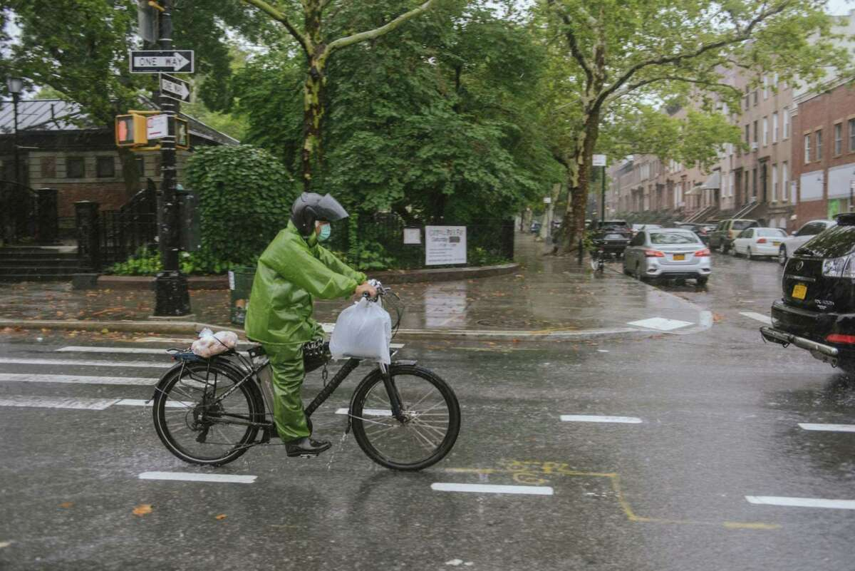 A delivery rider during tropical storm Henri in the Brooklyn borough of New York on Aug. 22, 2021.