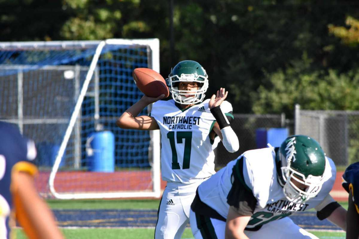 Northwest Catholic's Matt Churchro throws the ball against Weston at Weston high school on Friday, Sept. 27, 2019.