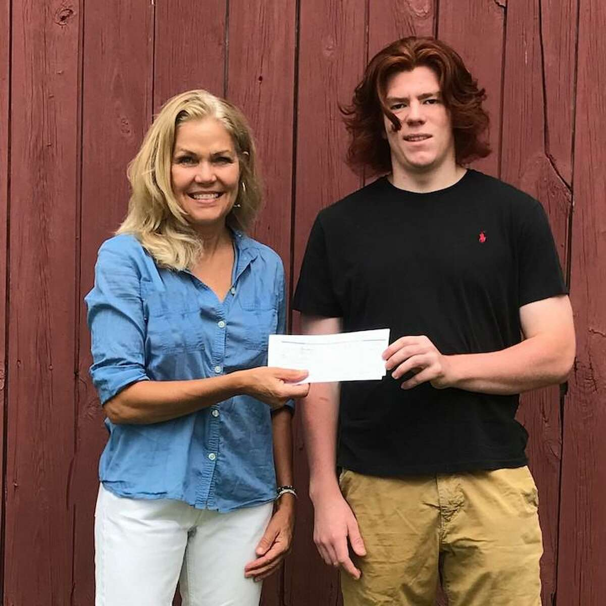 The co founders, of the company, and the creator of the original ponytail hat, Trailheads, in Kent, Connecticut, recently presented the first recipient of the company's $500 Housatonic Valley Regional Scholarship Award, (HVRHS), on Thursday, July 29, to Patrick Merrill of Lakeville, Connecticut, and who is attending the Culinary Institute of America in Hyde Park, N.Y., in the fall. Pictured are: Trailheads Co-Founder, and also President, Stephanie Raftery, and Merrill.