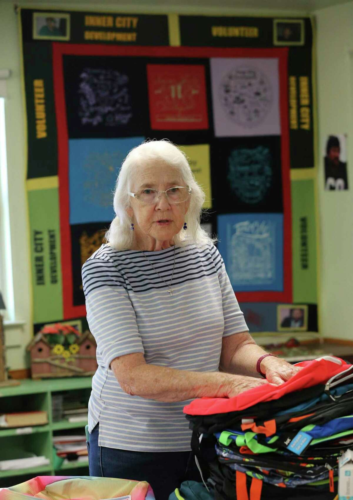 Patti Radle sorts through a pile of donated school supplies on a recent Friday. Through work on affordable housing, elected office and directing volunteers at a West Side nonprofit group, she and her husband, Rod Radle, have been helping the underserved in San Antonio for more than 50 years.