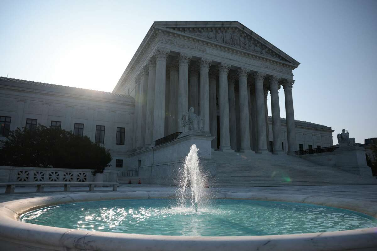 The sun rises behind U.S. Supreme Court building on Aug. 27, 2021 in Washington, DC. (Photo by Anna Moneymaker/Getty Images)