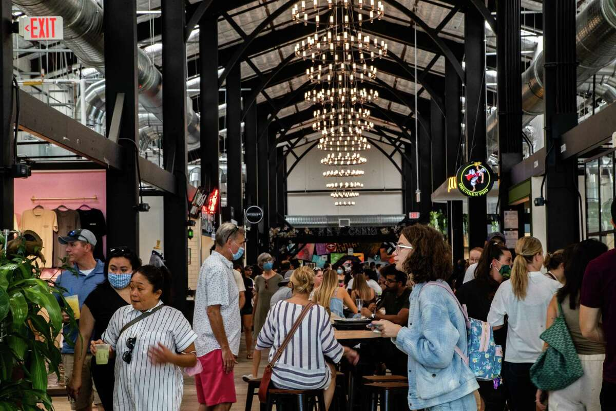 Railway Heights Market clients visit the Food Hall during the soft opening, Saturday, Aug. 21, 2021, in Houston.