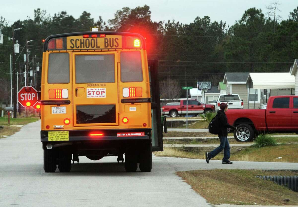 A lumberton student exits a school bus early Thursday evening. Photo taken Thursday, January 14, 2016 Guiseppe Barranco/The Enterprise