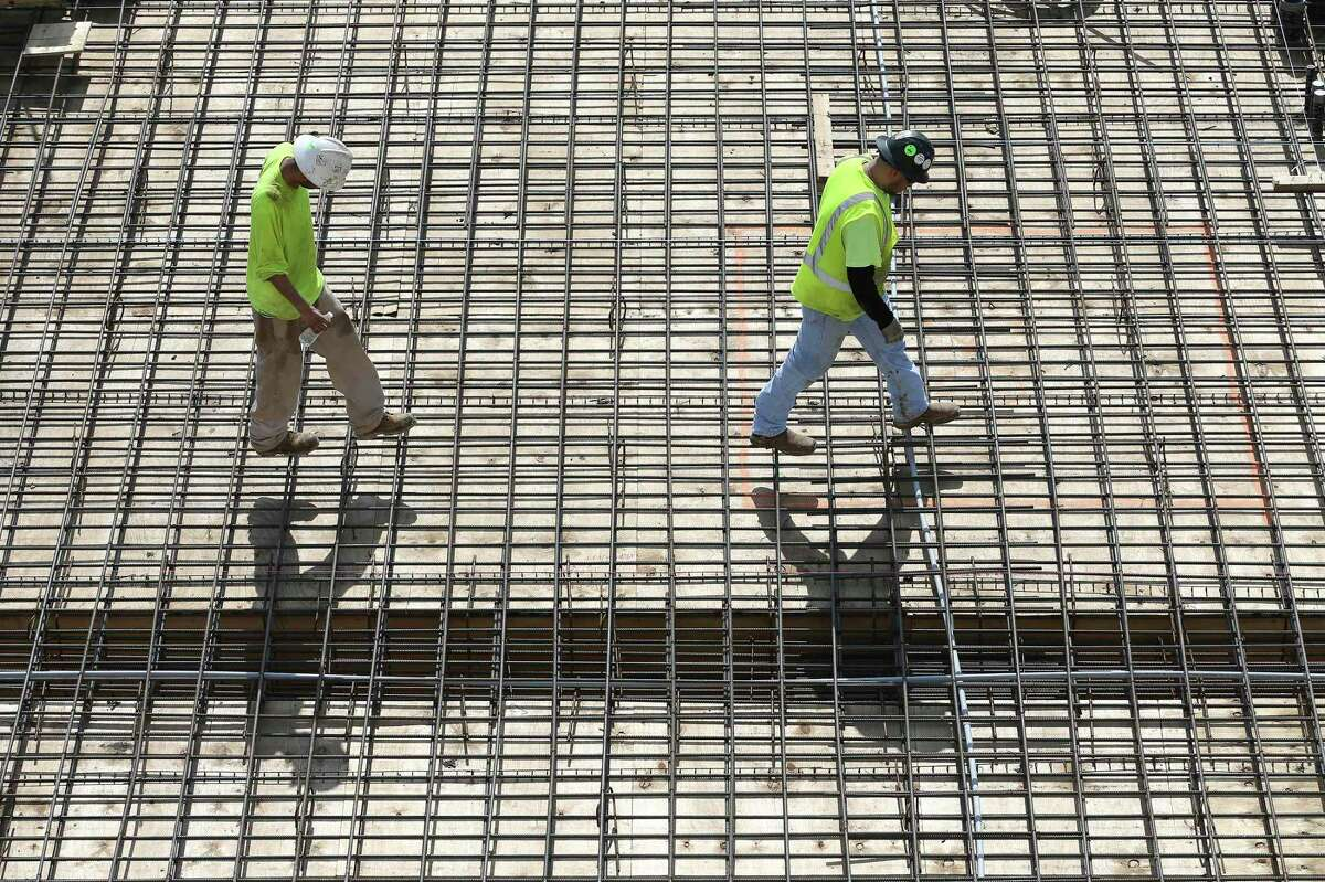 Workers lay rebar for concrete at a construction site at San Antonio College, Tuesday, May 18, 2021. It was announced on Tuesday that SAC was named the top community college in the US by the Aspen Institute.