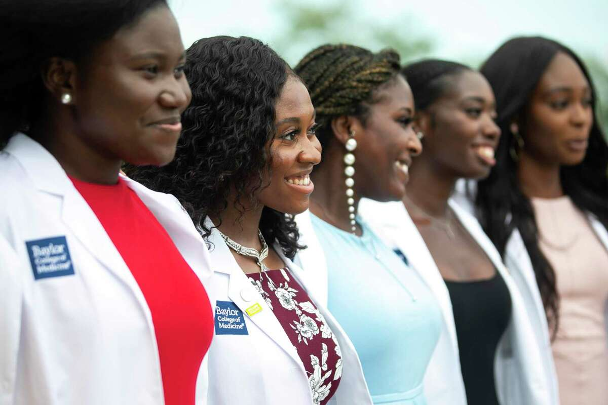 Baylor College of Medicine student Jennifer Onwukwe smiles with her peers after their white coat ceremony at the Bayou City Event Center on Friday, Aug. 13, 2021.