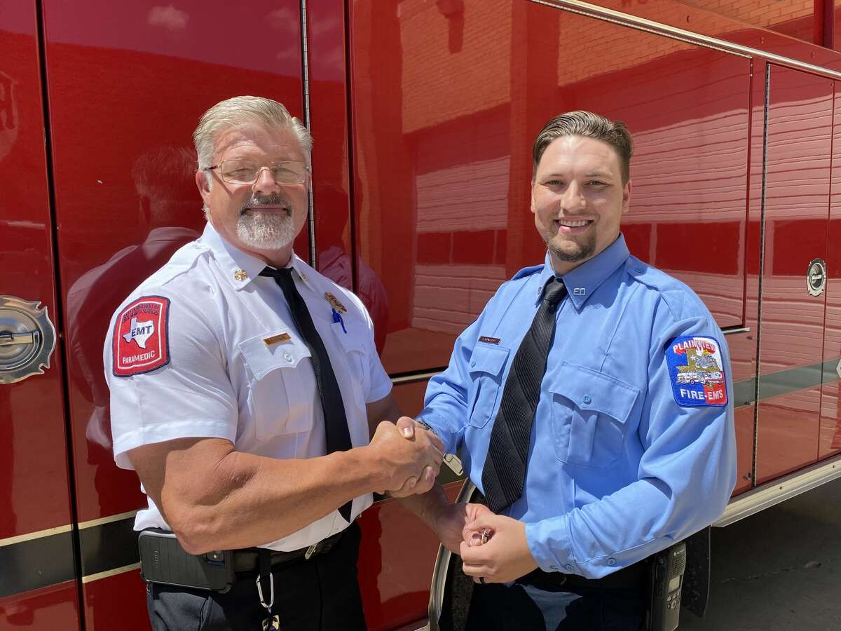 Interim Fire Chief Bobby Gipson presented Jesse Edwards with a badge for his promotion.