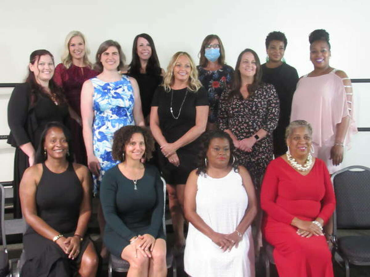 The 2021 Women of Distinction honored Thurday night included, from left, back row, Laene Deconcini, Amy Gabriel, Katie Stuart and Leah Becoat; middle row, Savanna Bishop, Lacy Spraggins McDonald, Jennifer Gottlob, Crystal Uhe and Yvonne Campbell; front row, Sandra West, Trish Holmes, Starette Smith and Marie Nelson. Not pictured are Carrie Schildroth and Cameo Holland.