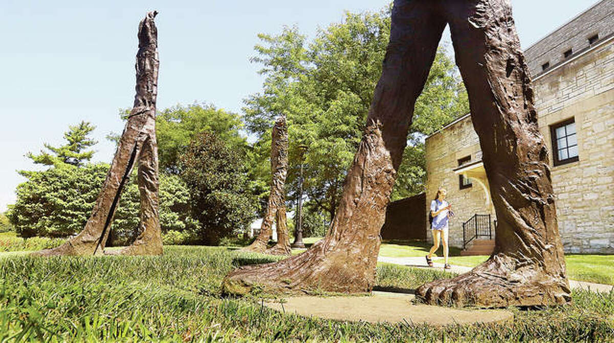 """There was a lot of walking going on Monday at Lewis and Clark Community College in Godfrey during the first day of classes for the fall semester. A student walks past the bronze sculpture called """"Five Walking Figures"""" dedicated in 2010 by Polish-born artist Magdalena Abakanowicz."""