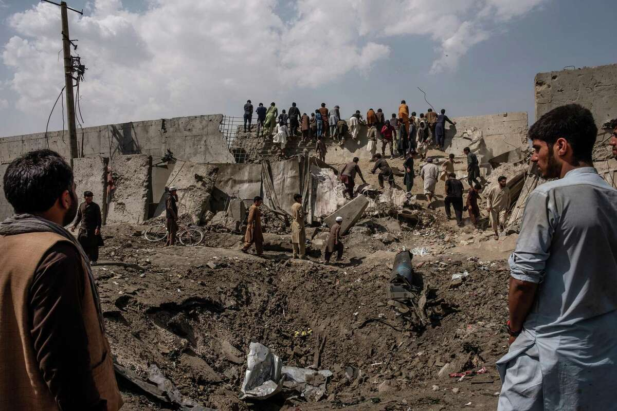 FILE - A crater left by a car bomb attack, for which the Taliban claimed responsibility, in Kabul, Afghanistan, Sept. 3, 2019. The U.S. invaded Afghanistan 20 years ago in response to terrorism, and many worry that Al Qaida and other radical Islamist groups will again find safe haven there. (Jim Huylebroek/The New York Times)