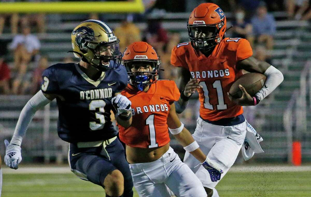 Brandeis QB JC Evans gets blocking from Aiden Inesta-Rodriquez(1) as he scrambles against O'Connor. Brandeis defeated O'Connor 33-7 in boys football game on Thursday, Oct. 26, 2021 at Farris Stadium.