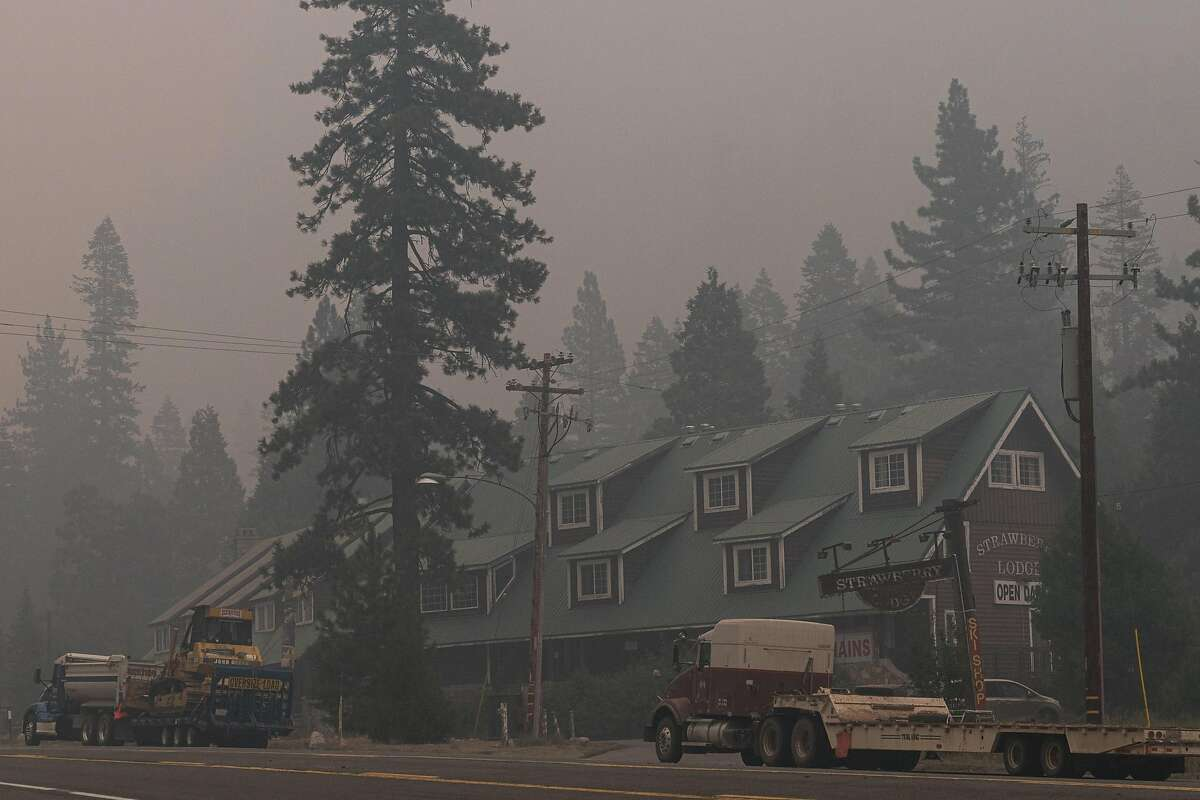 Caldor Fire support vehicles remain parked near Strawberry Lodge in Strawberry (El Dorado County).
