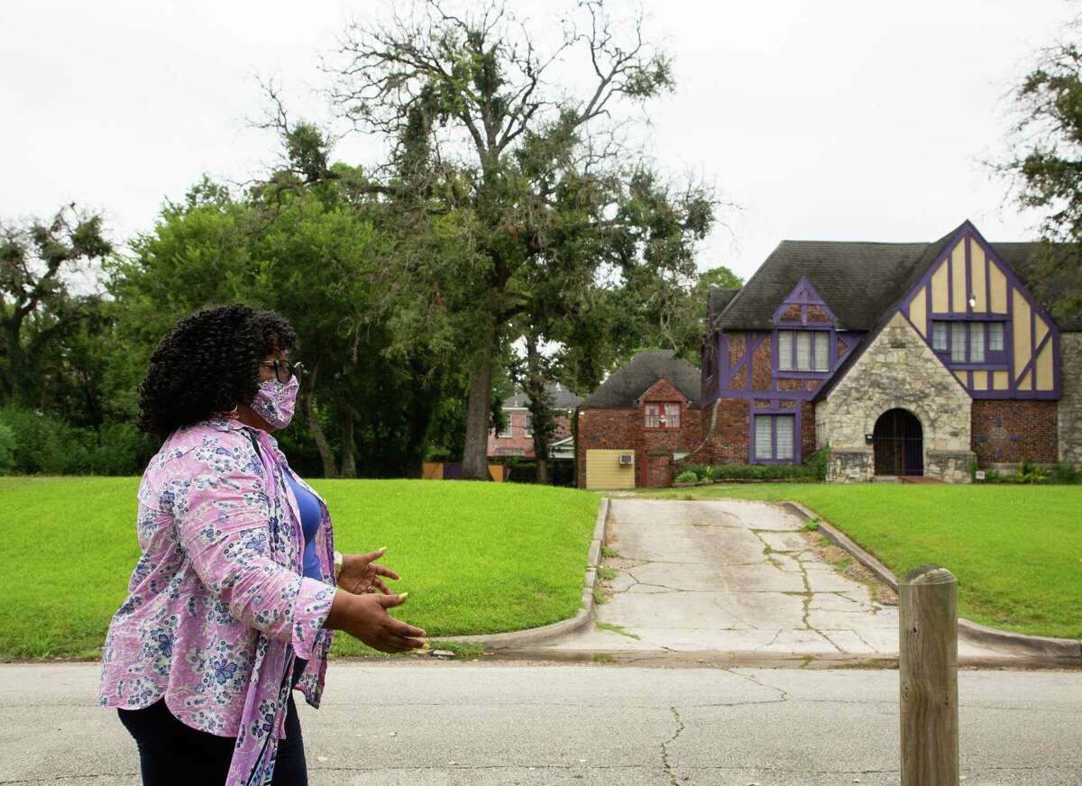 Tomaro Bell - chairman of the MacGregor Super Neighborhood group - walks along North Calumet Street, passing the Nu Phi Omega Psi Phi Fraternity house on Friday, Aug. 27, 2021, in Third Ward. Bell has lived in MacGregor/Third Ward for 35 years and watched as the neighborhood has changed.