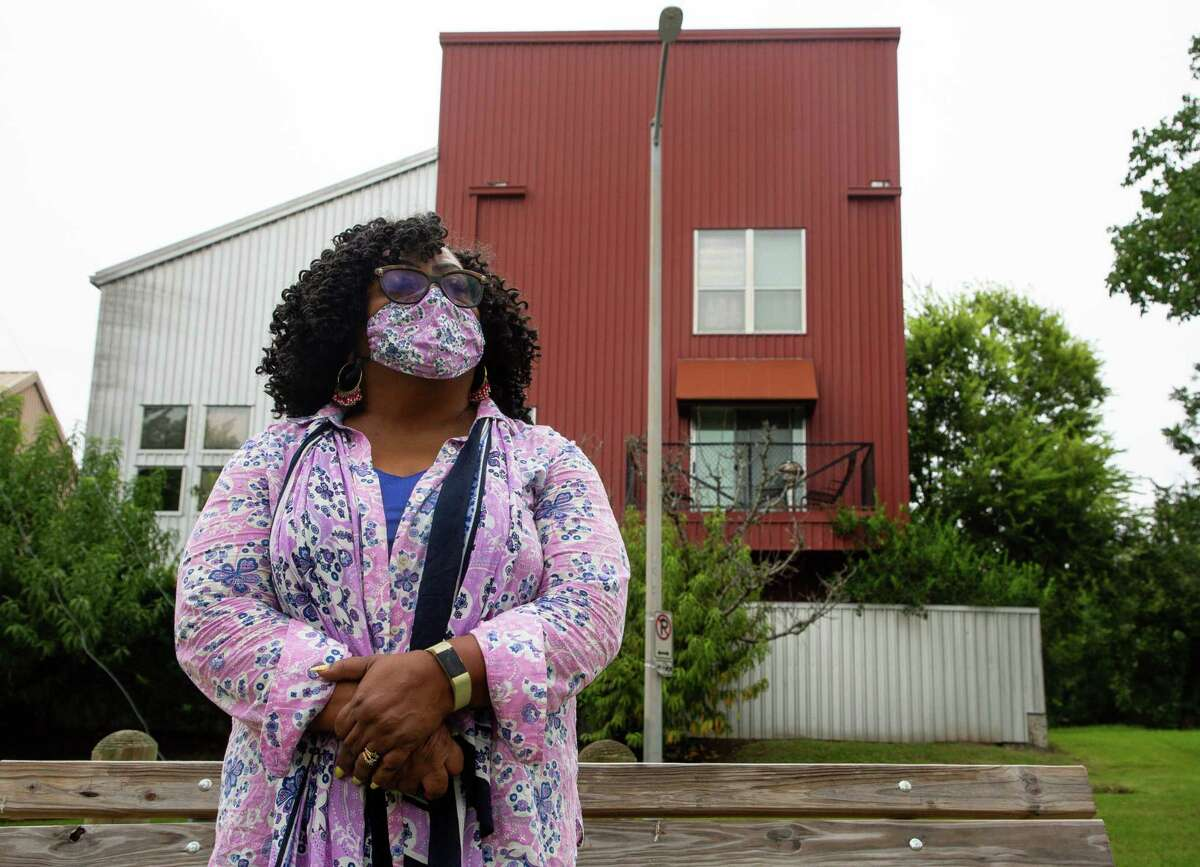 Tomaro Bell - chairman of the MacGregor Super Neighborhood group - poses for a photograph in front of townhomes which have been built recently, on Friday, Aug. 27, 2021, in Third Ward. Bell has lived in MacGregor/Third Ward for 35 years and watched as the neighborhood has changed.