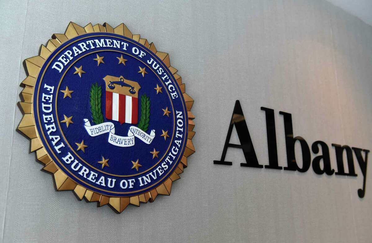 The Federal Bureau of Investigations seal hangs in the Albany field office outside FBI Special Agent in Charge Janeen DiGuiseppi?•s office on Friday, Aug. 27, 2021, in Albany, N.Y.